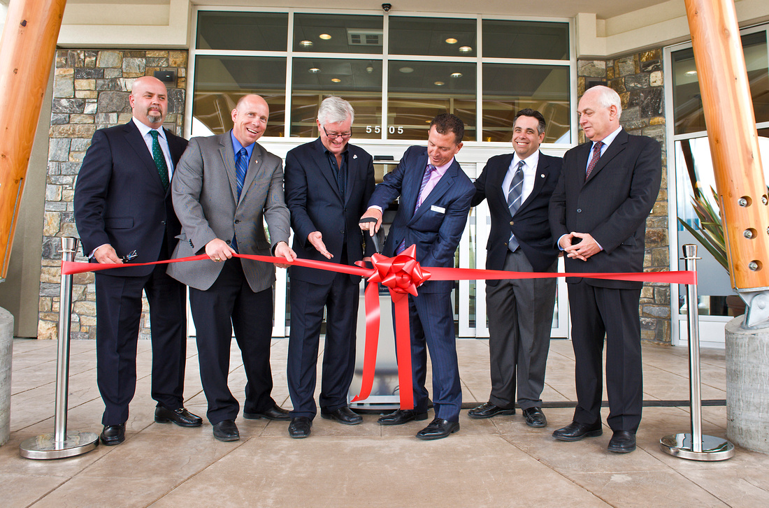 Cutting the ribbon at the grand opening of Four Points by Sheraton Airport in Kelowna, BC.